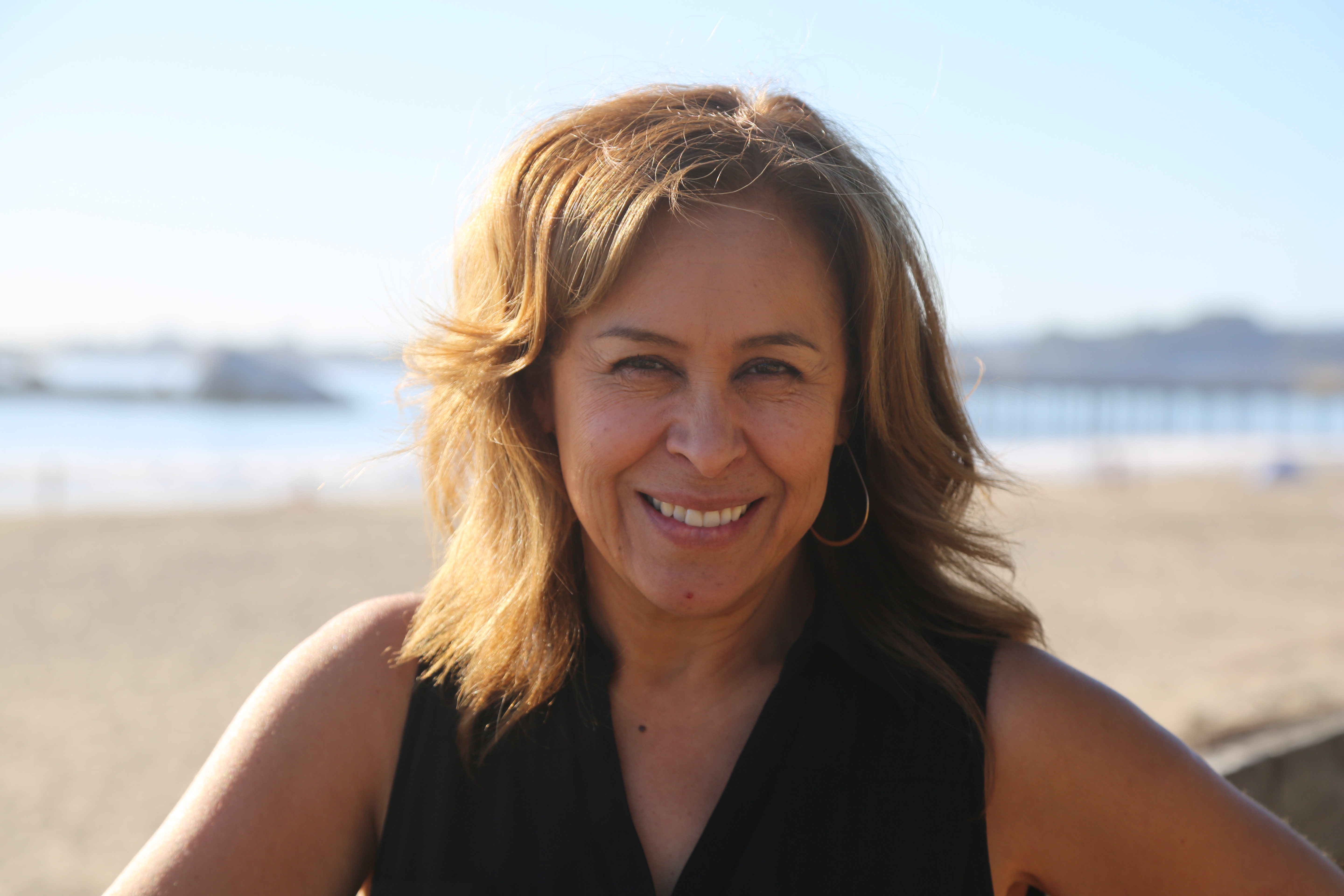 Laura Segura : Executive Director